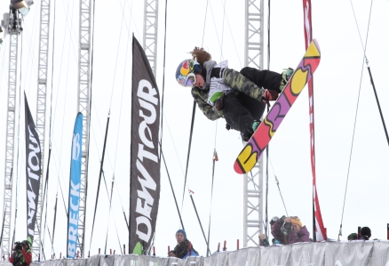 Ariel Gold reaches for a grab during competition at the annual Dew Tour at Breckenridge Resort.